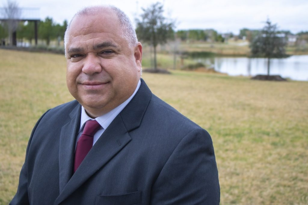 Jesse Zamaripa Standing Next To A Pond Near His Home In Fort Bend County Pct 3